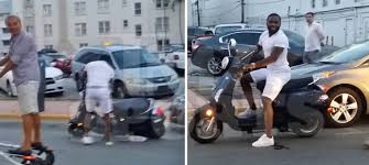 adrien-broner-crashes-his-scooter-into-a-parked-car-in-miami-video-HipHopSince1987.com-2014